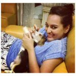 Sonakshi Sinha lying with cat