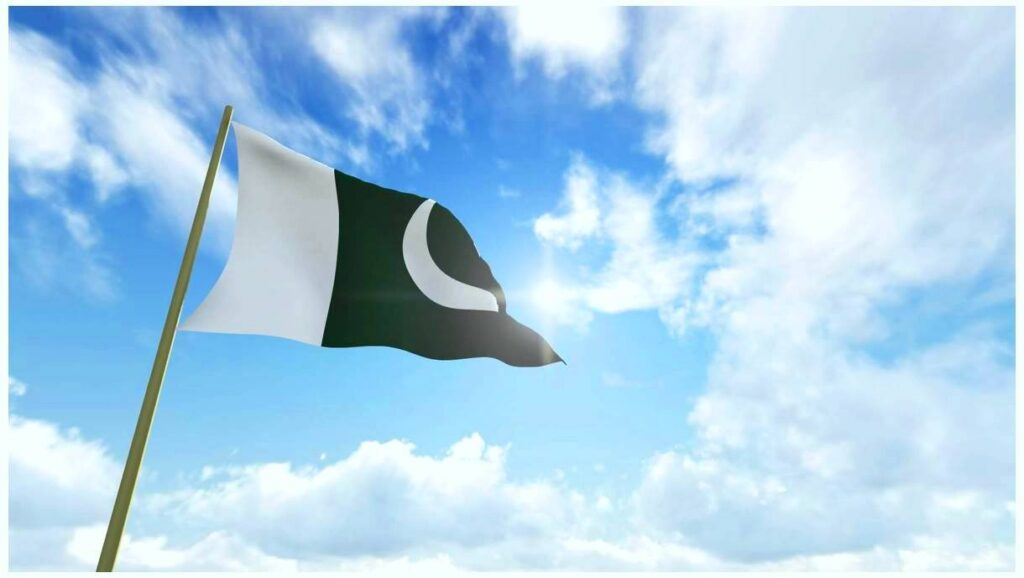 The Pakistan flag flying below blue sky Pics